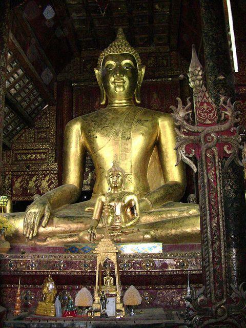 Chedi, Thailand - Buddha in Wat Phrathat Lampang Luang