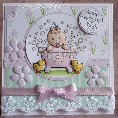 handmade card: Baby card soo cute .. awesome use of embellishments ... luv the shine from clear glaze on the bubbles ... another fab card by Debby