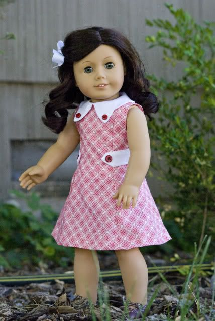 BunnyBear Princess Seamed dress with the sleeves omitted.