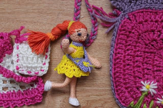 The tiny doll have small handbag, pillow and blanket!