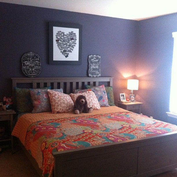 Heart print, gray walls, and coral bedspread, featuring the Hemnes Bed Frame in White from Ikea.