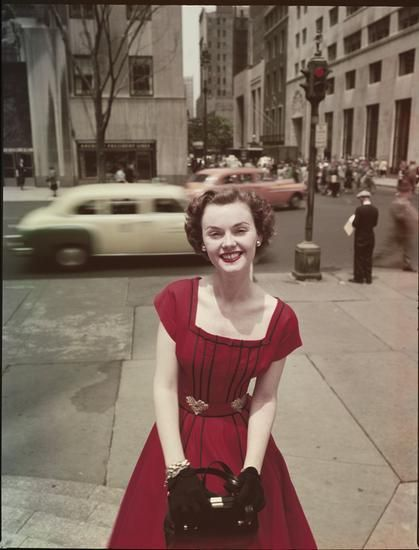 Lady in a red dress, New York City, 1950s. 50s found photo print ad street day