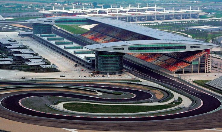 TODAY IN HISTORY -  On September 25, 2004, Chinese officials gather at the brand-new  Shanghai International Circuit racetrack in anticipation of the next  day's inaugural Formula One Chinese Grand Prix. #china #racing #history