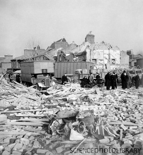 V-series missile damage. Destroyed homes in Camberwell Road, London, England, following a German V-series missile impact during World War II. A British flag is at lower right. London was targeted by both the V-1 flying bomb and the V-2 rocket during the war. Several thousands of both type were launched during 1944 and 1945, destroying many buildings and killing many thousands in London and elsewhere.