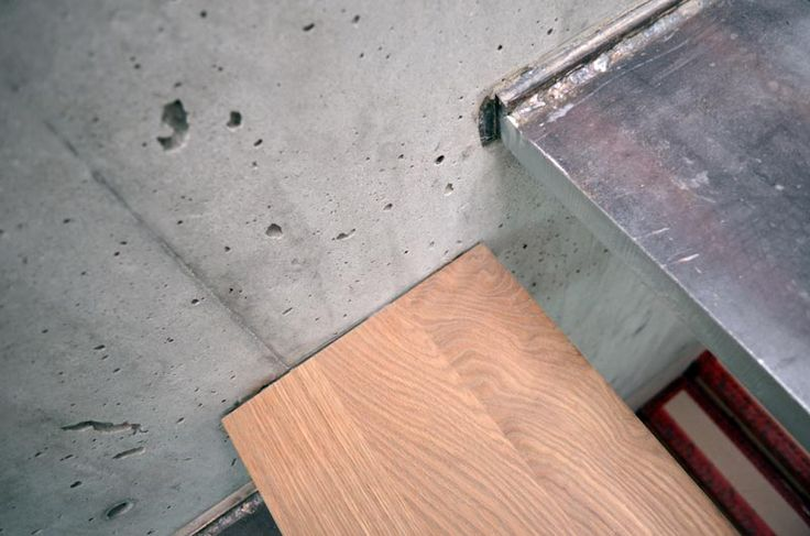 Steel Cantilevered Steps Attached To Concrete Wall Wood
