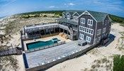 Wild Horse - T11870 is an Outer Banks Oceanfront vacation rental in Swan Island Estates 4x4 NC that features 23 bedrooms and 20 Full 3 Half bathrooms. This rental has a private pool, an elevator, and a pool table among many other amenities. Click here for more.
