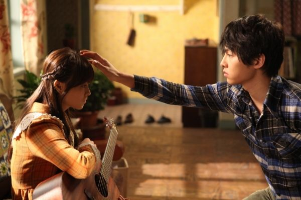 Song Joong Ki grows closer to Park Bo Young in the 2012 fantasy hit, 'A Werewolf Boy.'