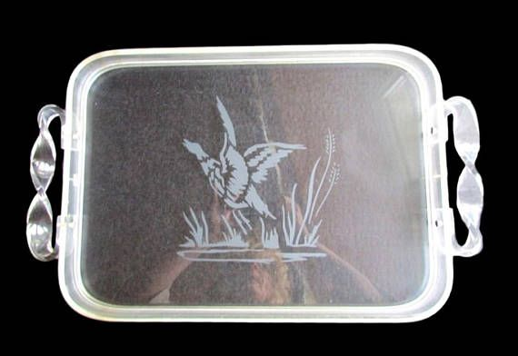 This etched Lucite Acrylic tray has an excellent wild duck/ geese taking off out of the pond with Cattails. It is a clear acrylic with twisted handles to add more character... #etsyshop #vintage #antiques #upcycled #handmade ➡️ http://jto.li/98feh
