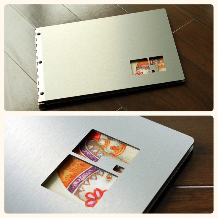 custom brushed silver aluminum portfolio book with cut-out treatment by klo portfolios