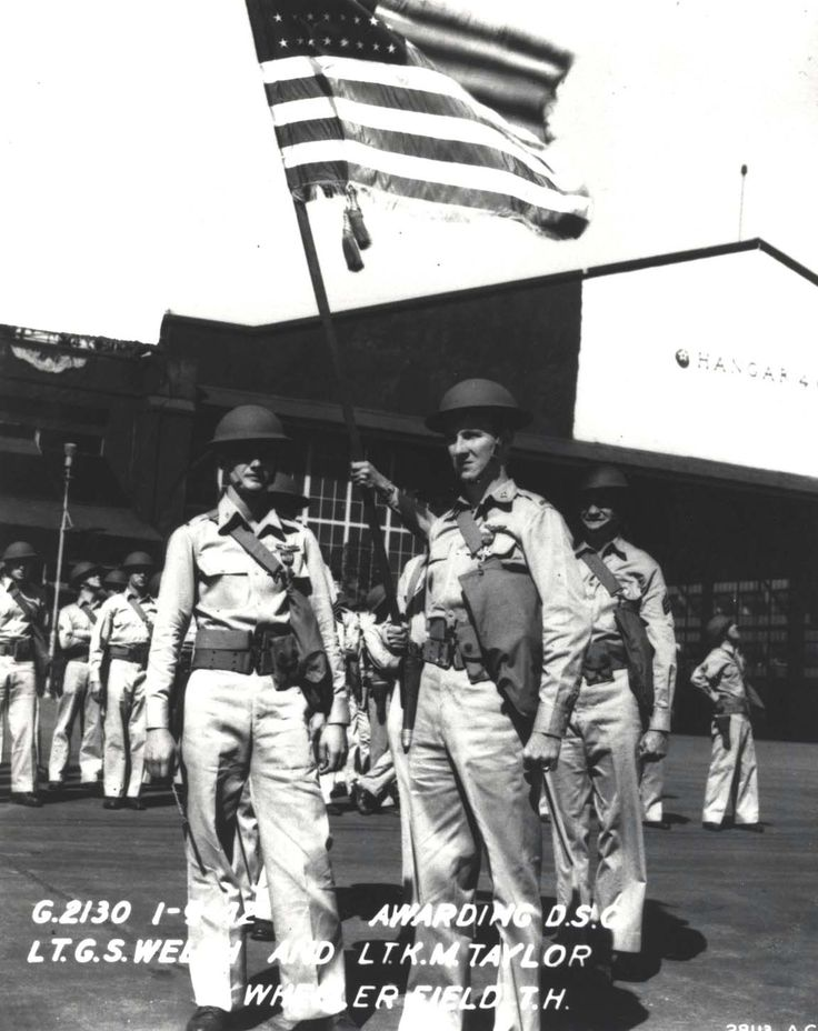 Lt George Welch and Lt Ken Taylor pose for a photograph after the ceremony at Wheeler Field, Hawaii, Jan 9, 1942 where each was presented with the Distinguished Service Cross for their actions on Dec. 7, 1941 (US Army Air Force)