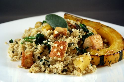 warm millet salad with delicata squash, crispy tofu, and spinach