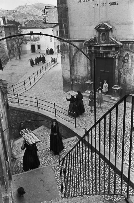 True black and white. defined lines, foreground and distance, a story unfolds... Henri Cartier-Bresson - Makes your eye move around the picture.