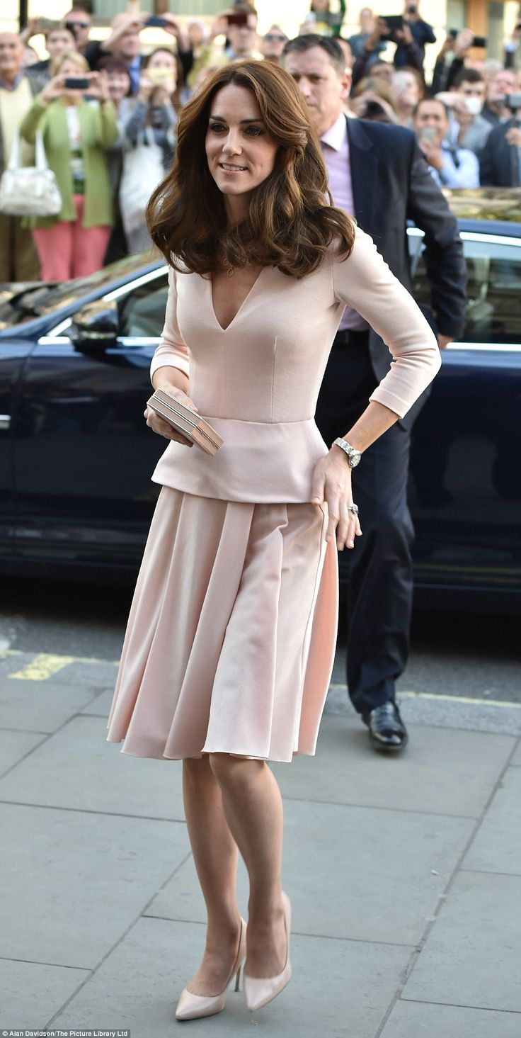 Kate's dress has a flattering waist with a pleated skirt as she was met by the gallery's d...