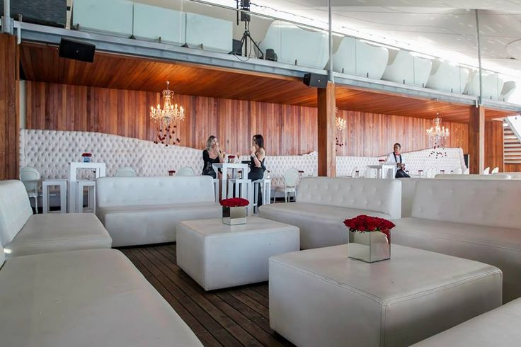 The white couch on our Pool Deck can be hired for a function or party.  www.shimmybeachclub.com