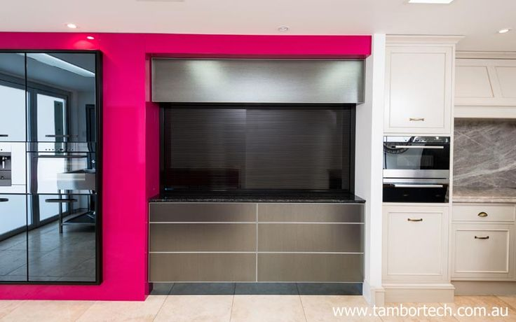 Kitchen design ideas - hide all your clutter away behind a beautiful door. It's not a roller shutter door... it's a Tambortech Door
