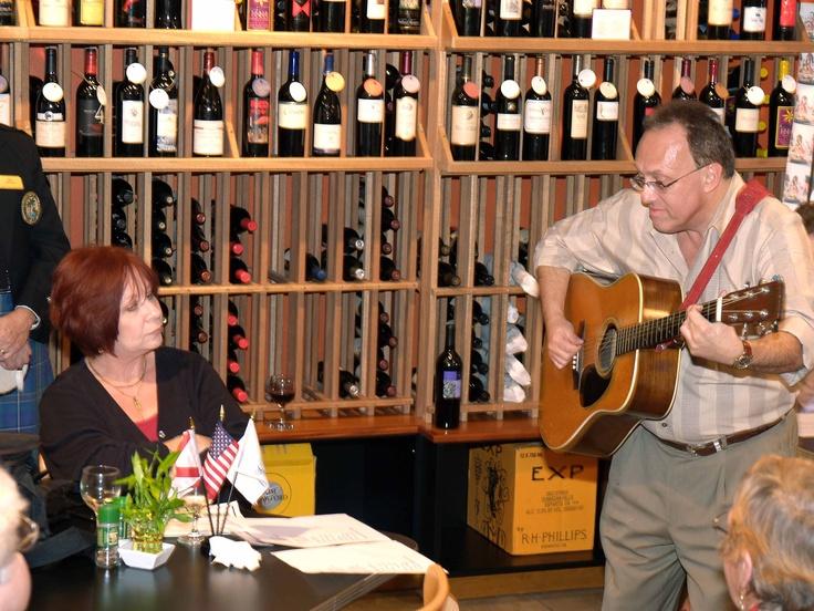 "Sid Krupkin entertains at the January 2006 Sarasota Sister Cities New Members orientation at Southgate Gourmet in Sarasota.  Sid has written two songs about Sarasota Sister City relationships: ""Sarasota & Hamilton Sunsets"" and ""Sarasota & Tel Mond"""