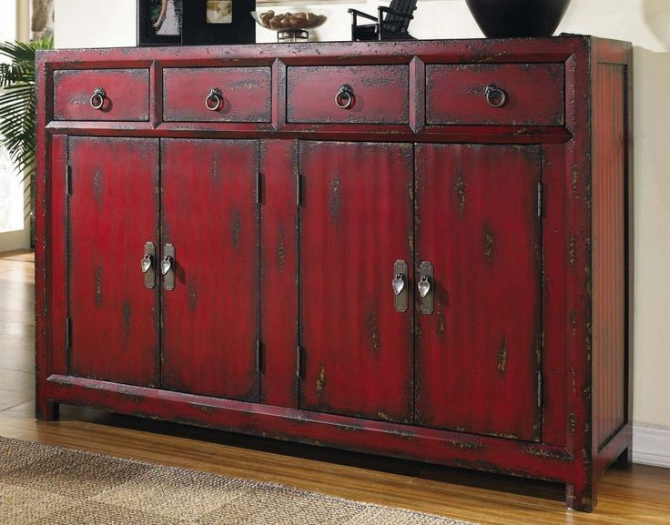 red painted antique vanity from teak wood planks on rustic red paint