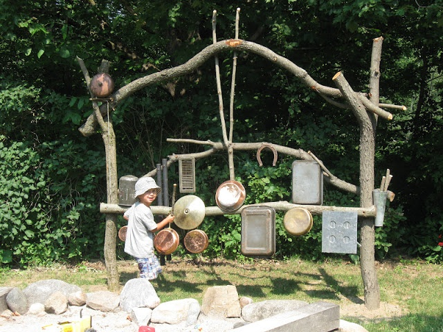 outdoor music wall made from old kitchen pots/pans and found branches (from Mothering with Mindfulness)