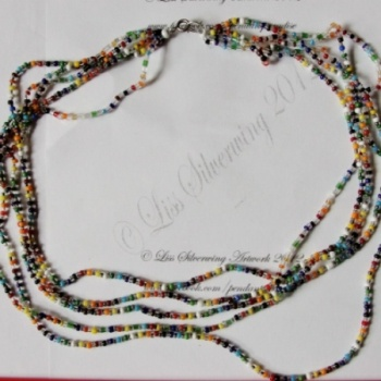 I checked out Rainbow seed bead necklace on Lish, € 35,00