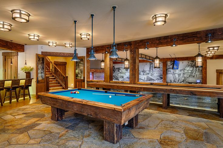 Sumptuous shuffleboard table for sale in Basement Rustic with Pool Table next to Gameroom alongside Game Room Flooring and Natural Stone Flooring