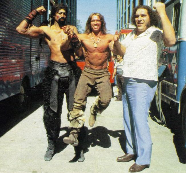 Wilt Chamberlain and Andre the Giant holding up Arnold Schwarzenegger
