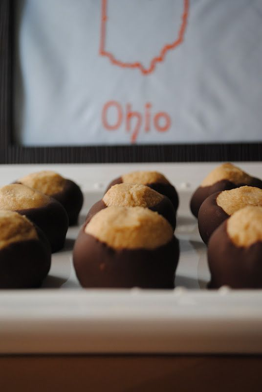 O-H-I-O = Buckeyes! Real Buckeyes are the tree nut produced by the Buckeye tree native to the state of Ohio...      But some genius in O...