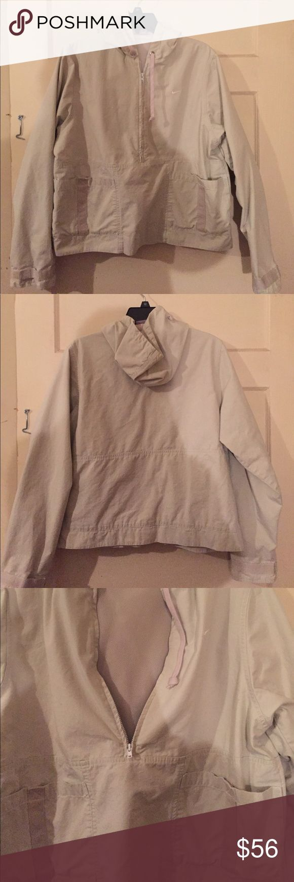 Women's Nike jacket🌸 Light Khaki colored jacket... half zip front.. Velcro pockets on front.. sleeves also have Velcro to tighten or loosen... also has a good.. inside has mesh lining... see pics for material and washing instructions Nike Jackets & Coats