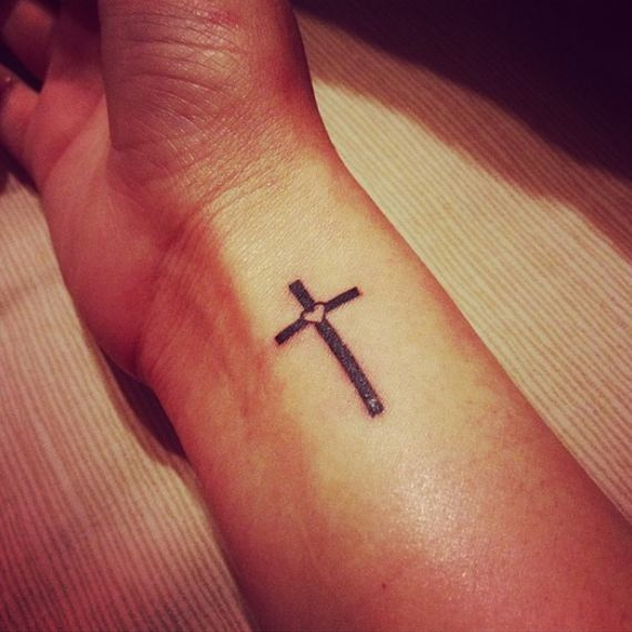 Simple and sweet cross tattoo. Want on my back with my grandpas initials and dates.