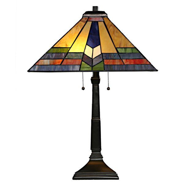 Capture the beauty of a southwestern sunrise in any room with this beautiful lamp. The cool blues and purples and warm oranges and yellows will bring the beauty of a Sedona sunrise to any room. Crafted with 96 pieces of hand cut glass. Perfect for a bedside table or desk lamp! The lamp requires two 60W bulbs (not included).
