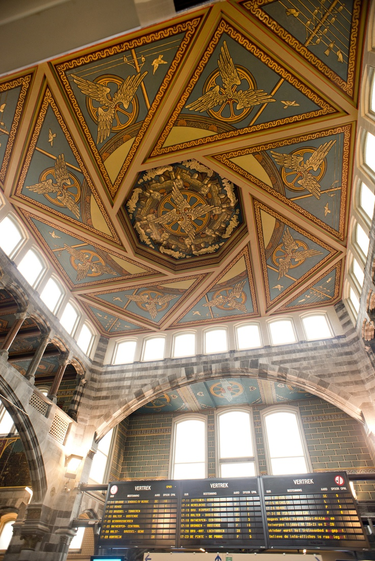 This beautifully decorated ceiling can be found at Ghent train station in Belgium