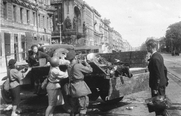 The siege continue`s as Soviet`s fight back . The remain`s of Russian civilian`s - who fell victim to a random German shell - during the siege of Leningrad summer 1943