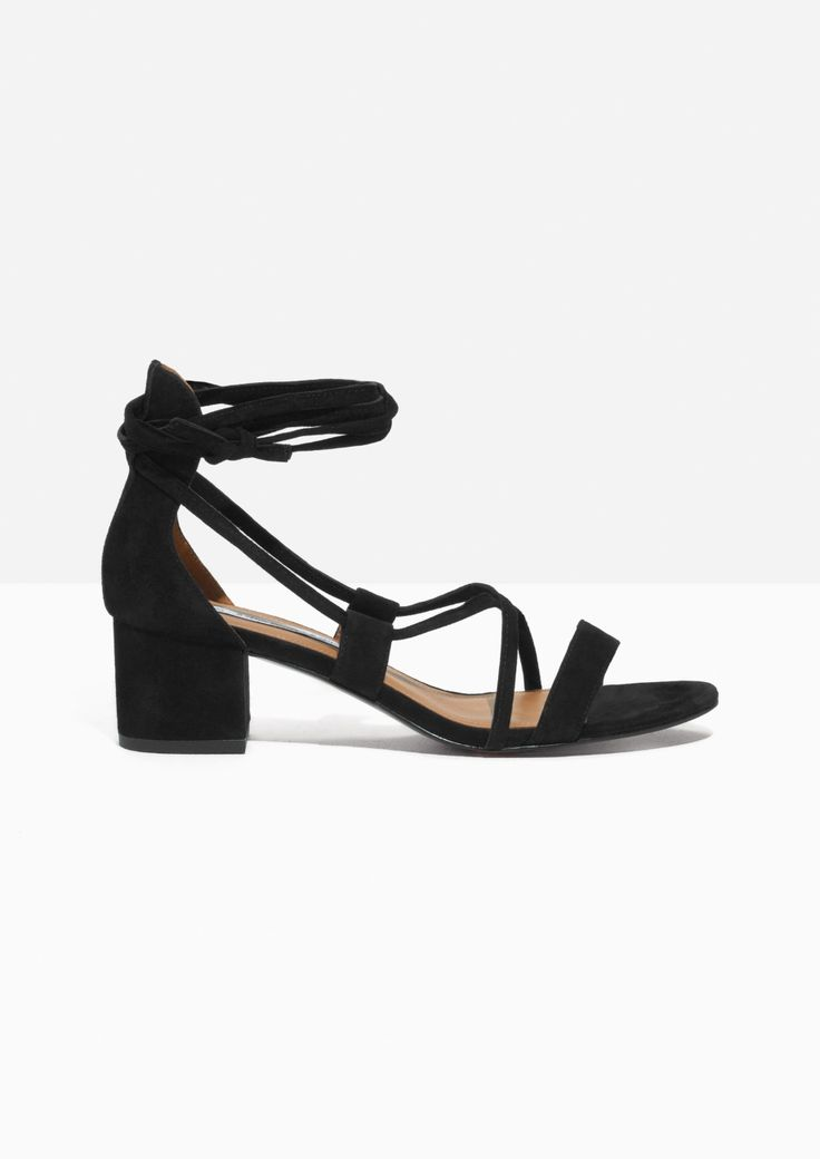 This suede sandalette combines both elegance and urban design, featuring a  decorative laser cut out detailing and lace up closure.