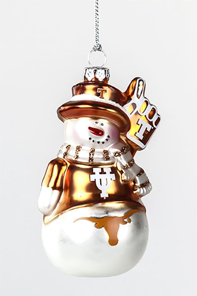 """Add some Longhorn pride to your tree with the Texas Longhorn Glass Snowman Ornament! This adorable snowman is all dressed up in its Texas best and ready to cheer the Horns on to victory! This glass blown decoration measures approximately 3.75"""" x 2.25""""."""