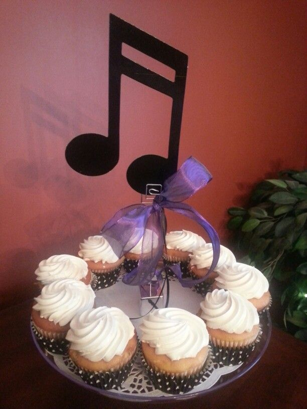 Musical note cupcake centerpieces for high school band banquet.