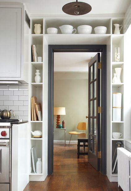 Shelving around a doorway for extra storage in a small kitchen