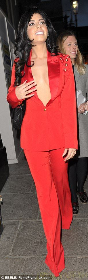 Going it alone! Love Island's Cara de la Hoyde went braless in a plunging red suit as she was pictured for the first time since confirming her split from Nathan Massey
