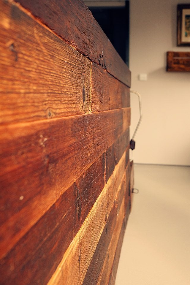 the headboard of the bed in fusion vintage is made of floorboards that are over 150 yrs old. www.tinquer.com