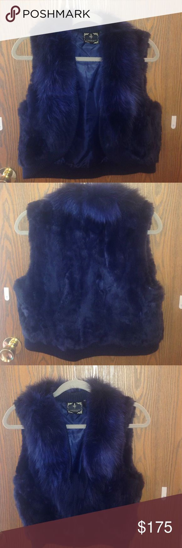 """Navy Blue Rabbit Vest with Fox Collar💎 Couture Romeo & Juliet Luxe fur vest. This one ladies is one of my favs!!! It compliments everything! Look chic with a pair of jeans, perhaps pair it with a pencil skirt and chambray shirt... I've even worn this beauty with a jogging suit 😬 This is a purchase you won't regret!!   21"""" long and 17.5"""" wide.  The Vest has two ribbons that you can tie in the front or leave hanging- totally up to you!! Romeo & Juliet Couture Jackets & Coats Vests"""