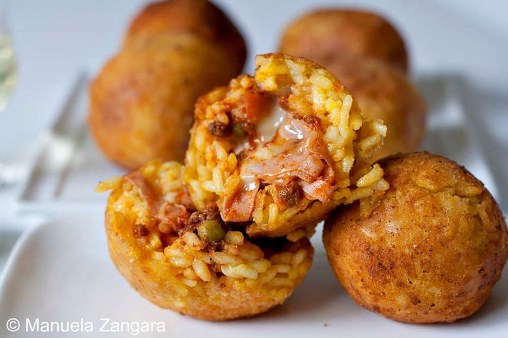 Street food in Sicily - arancine (risotto rice balls stuffed with ragù)