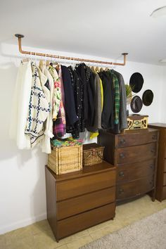 """Admittedly, I have an ample closet, and I am aware of how lucky I am to have such an amenity, though this hasn't always been the case. Many of the """"closets"""" I had in previous addresses were sad excuses for clothing storage, and I had to get creative to deal with my shoe- and cardigan- buying addiction. If you're dealing with a lack of wardrobe space, or simply have no closet at all—a common concern in dorm rooms, studio apartments or homes outside the US—here are 6 strategies (some I've…"""