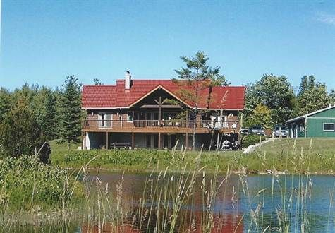 Gorgeous log home on 59 acres with 6 trout ponds. Across road from McCollough Lake and Saugeen Conservation Lands.  Public beach at end of the road. 4 bedrooms and 4 bathrooms, 5560 sf total living space.  Lower level with 3 walkouts. 4 fireplaces. 2 whirlpool tubs.  Just west of Williamsford, south of Chatsworth, 170 km north west of Toronto.  Property taxes $5,500. Asking $2.1 mln http://www.real-estate-ontario.ca/Listing/ViewListingDetails.aspx?ListingID=53990398…