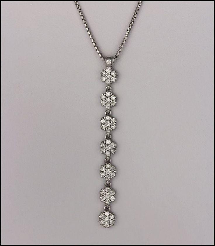 Ref- 2R Pendiente con 7 flores en diamantes.