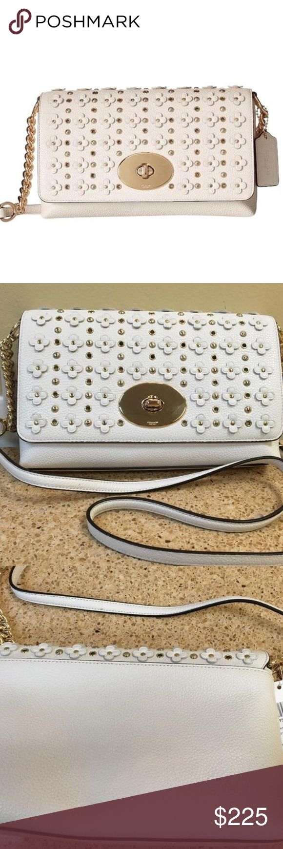 """Coach Crosstown Crossbody in Floral Rivets Leather Coach Crosstown Crossbody in Floral Rivets Leather in Chalk. Style Number: 37704 Floral rivets, grommets and studs add downtown edge to a chic pebble leather design finished with a richly plated update of the iconic Coach turnlock. Sling it over your shoulder or wear it crossbody for effortless on-the-go style.  Polished pebble leather Inside multifunction pockets Turnlock closure, fabric lining Strap with 22"""" drop for shoulder or crossbody…"""