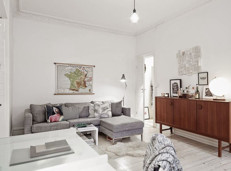 A serene white and grey home with a mid-century touch. Stadshem.