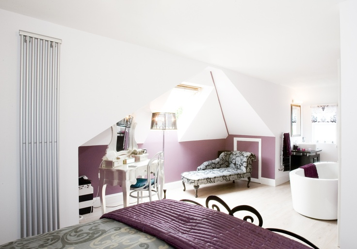 This bedroom has a boudoir feel, which is perfect for romantics.