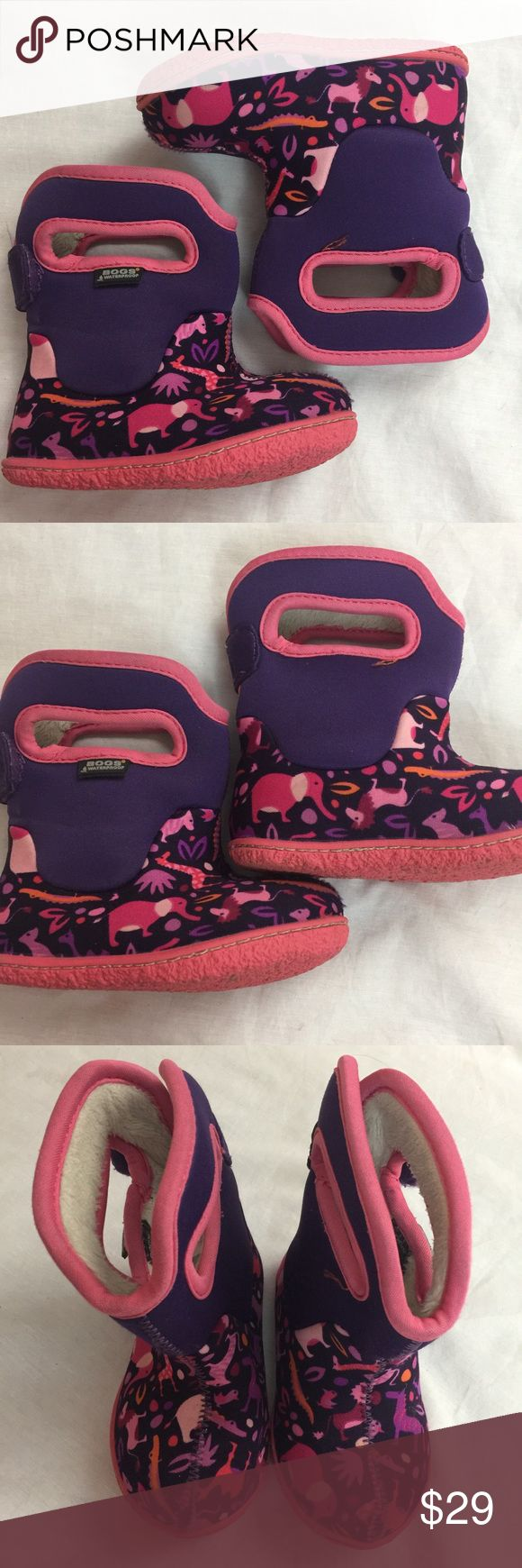 Toddler size 5 Adorable animal print Bog boots Toddler size 5  Adorable animal print Bog boots  Bright pink & purple boots Lined booty  Waterproof Great condition, minor wear from use. Debris on the soles.  Love these boots! Great for excursions with your little one. Lots of life left! Bogs Shoes Boots