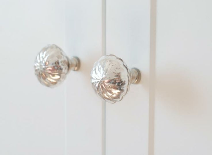 Wardrobe detail, antiqued glass mirrored knobs from Anthropologie. Custom wardrobe designed by Kate Connors, photographed by Sam Jervis.