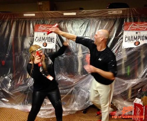 Lots of players pouring beer and champagne on the ladies after this one. Here's Tim Hudson battling Madison Bumgarner's wife, Ali. *Credit: BASG