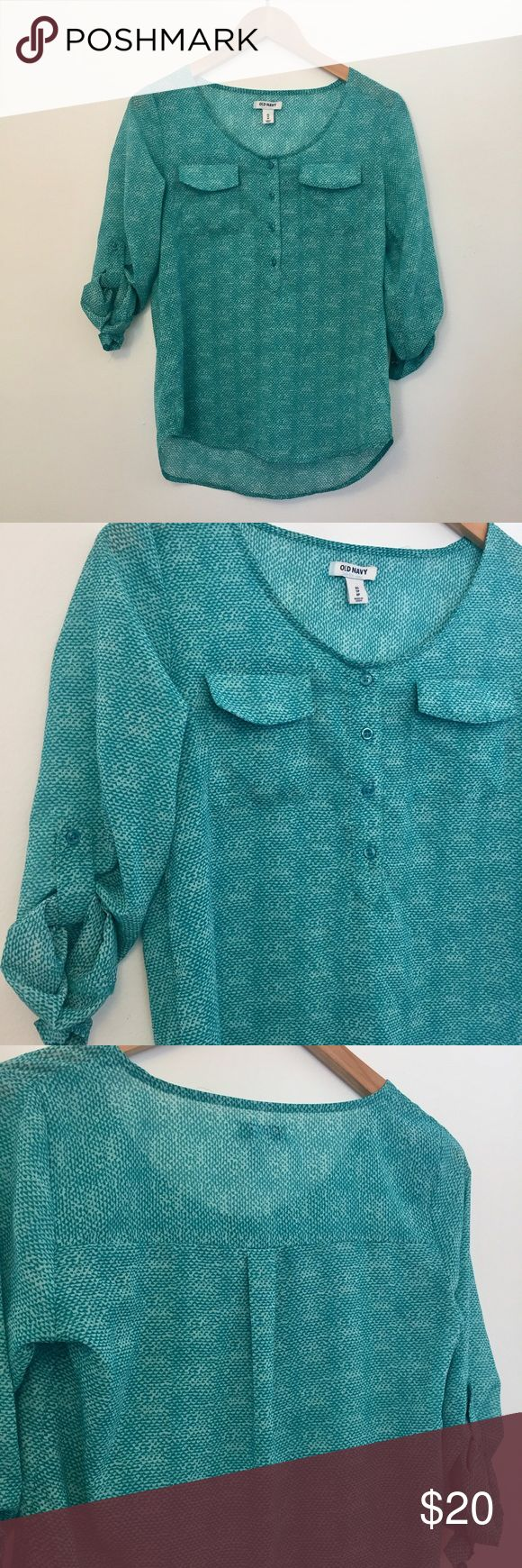 Old Navy • Button Blouse The perfect blouse for work or a casual day. 3/4 button down with rolled up sleeves that button, two pockets at the bustline. Pleating in the back for added interest. Loose flowy feel throughout. Is see through slightly so you will need a nude cami. Greenish blue color. Polyester. No flaws Old Navy Tops Blouses