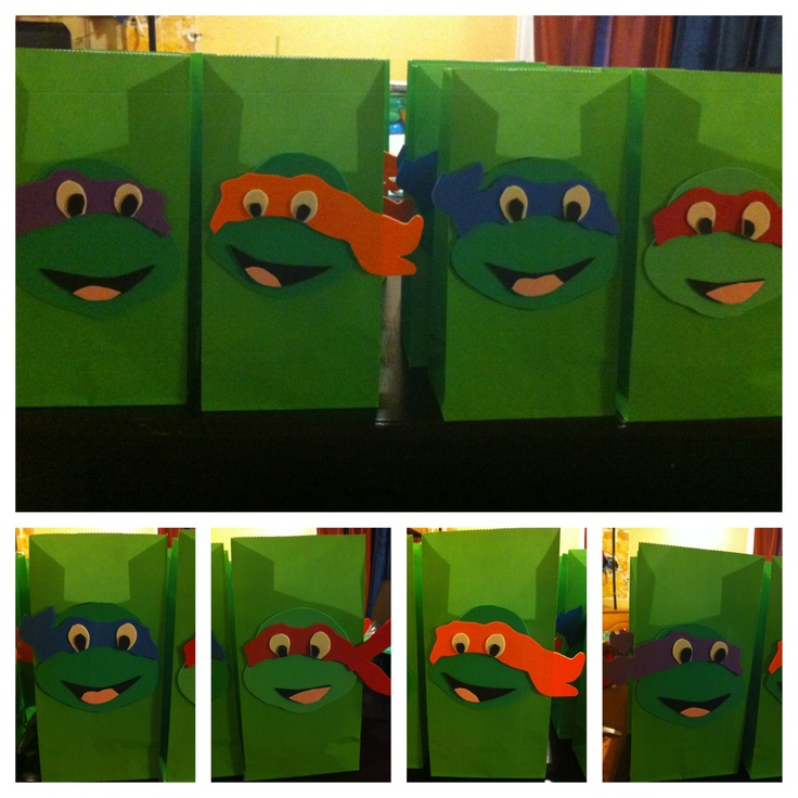 3D Foam teenage mutant ninja turtle gift bags. I found turtle heads I liked online, enlarged them to the size I needed, and cut each piece out individually (eyes, pupils, two parts of the mouth, the bandana. I then traced them backwards on foam, cut them out and assembled them.